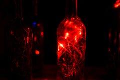 Glasflasche in Laserlichten Lizenzfreie Stockbilder