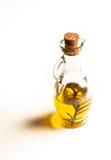 Glasflaska av olja med kork Arkivbild