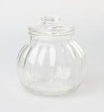Glasflaska- eller godiskrus på en bakgrund Royaltyfri Foto