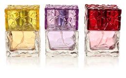 Glasflaskor av doft som isoleras på vit Royaltyfri Bild