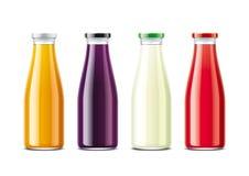 Glasflaskor för fruktsaft och sodavatten Metalllock Arkivbild