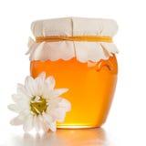Glasgefäß mit Honig stockbild