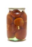 Glasglas mit konservierten Tomaten Lizenzfreie Stockfotos