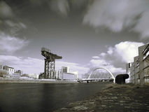 Glasgow clyde river. Infrared picture of Glasgow clyde river with Finnieston crane and bridge Stock Photos