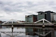 Glasgow financial center. Glasgow: pedestrian bridge of modern design, close to the financial center Stock Images