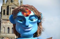 Grote Mens die, het KoopvaardijFestival van de Stad, Glasgow lopen Stock Afbeelding