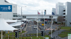 Glasgow International Airport. Drop off and pick up  site with British, Scottish and European Union flag Stock Photos