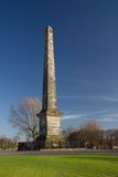 Glasgow obelisk. The obelisk on Glasgow Green against a blue sky stock images