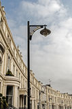 Glasgow Royal Crescent. Streetlight on Glasgow Royal Crescent. Blue sky and white clouds Stock Image