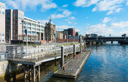 Glasgow Riverside. Glasgow's river Clyde riverside with a pier and city skyline in the background royalty free stock image