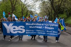 March in Glasgow: Crowd of People with Flags and YES Banner. Glasgow, Scotland - 04 May 2019: March in Glasgow: Crowd of People with Flags and YES Banner royalty free stock image