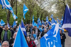 March in Glasgow: Crowd of People with Yes Scottish Flags. Glasgow, Scotland - 04 May 2019: March in Glasgow: Crowd of People with Yes Scottish Flags stock photos