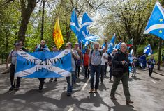 March for Indyref 2, People with Scottish Flags and Banner `Aye 2Indy Islay`. Glasgow, Scotland - 04 May 2019: March for Indyref 2, People with Scottish Flags royalty free stock images