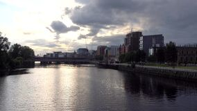Glasgow, Scotland river Clyde and cityscape during the late afternoon