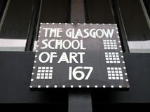 Close up of sign at the entrance to the Glasgow School of Art building, designed by architect Charles Rennie Mackintosh. Glasgow, Scotland, UK. Close up of sign royalty free stock photography