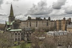 Glasgow Cathedral and Victoria Infirmary. Glasgow St Mungo`s Cathedral viewed from the city`s Necropolis graveyard. Founded in the 12th century it was one of the Royalty Free Stock Image