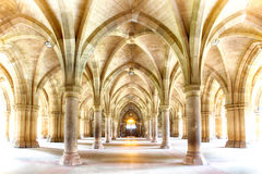 Glasgow University Cloisters. Sunlight streams into the historic Cloisters of Glasgow University. Subtle HDR processing Royalty Free Stock Image