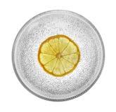 Glaskom met citroen en bellen stock afbeelding