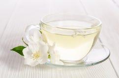 Glaskop thee met jasmijn Stock Fotografie