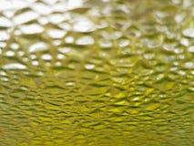 glaskorrels met gele, vuile, geweven achtergrond Stock Foto