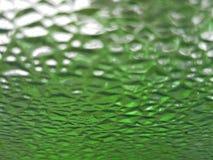 glaskorrels met groene, vuile, geweven achtergrond Stock Afbeeldingen