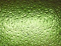 glaskorrels met lichtgroene, vuile, geweven achtergrond Royalty-vrije Stock Foto's