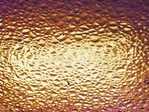 glaskorrels met oranje, vuile, geweven achtergrond Royalty-vrije Stock Afbeelding