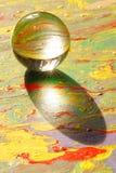 Glaskugel auf Anstrich Lizenzfreies Stockfoto