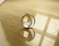 Glaskugel auf einem Parkett von einem Bambus Stockbilder