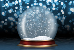 Glaskugel mit Schnee vom Hintergrund Stockfoto