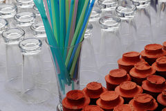 Glass�straw and clay cup Stock Photo