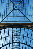 Glass. Detail of modern building made of glass against blue sky Royalty Free Stock Photos