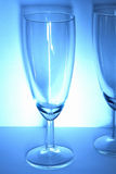 Glass. Wine glasses on the white and blue background with delicate shadow Royalty Free Stock Image