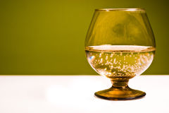 Glass. Vessels standing on the white table, isolated background royalty free stock photos