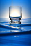 Glass. A glass isolated on a water-like background Stock Photography