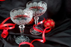 Glass. Wine and red christmas balls Royalty Free Stock Images