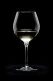 Glass. Of white wine on black background Royalty Free Stock Images