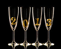 Glass 2013. Four glass goblet for champagne with numeral 2013 on black background, New Year concept photo royalty free stock photos