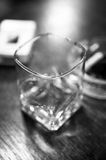A glass. A whiskey glas standing on a table Royalty Free Stock Images