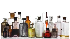 Glass. Old pharmacist's bottles and beakers on white Stock Photography