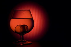 Glass. With wine and spheres Stock Photography