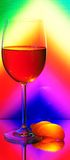 Glass. Elegant Tall Wineglass For Red Wine And Segments Of Mandarin  Over Motley  Background Stock Photos