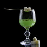 Glass of absinthe. With lump sugar royalty free stock image