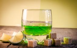 Glass of absinthe. With lime and sugar cubes stock photography