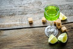 Glass of absinthe. With lime and sugar cubes royalty free stock photos