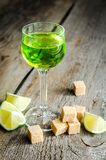 Glass of absinthe with lime and sugar cubes Stock Image