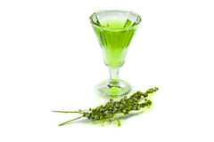 Glass of absinthe. A glass of absinthe with a sprig of tarragon Royalty Free Stock Photo