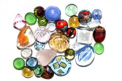 A glass accessory. A small diverse and colorful glass jewelry royalty free stock photos