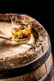 Glass of aged Scotch in the distillery basement Royalty Free Stock Photography