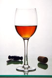 Glass of alcohol, cork and a corkscrew. Royalty Free Stock Image